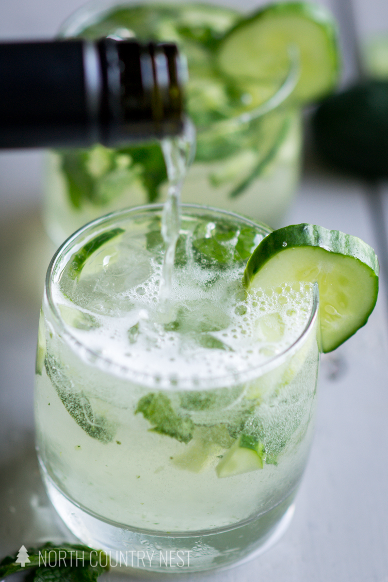 cucumber mint champagne cocktail on gray board
