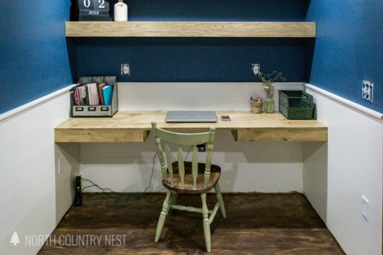 rustic home office with floating shelves and floating desk
