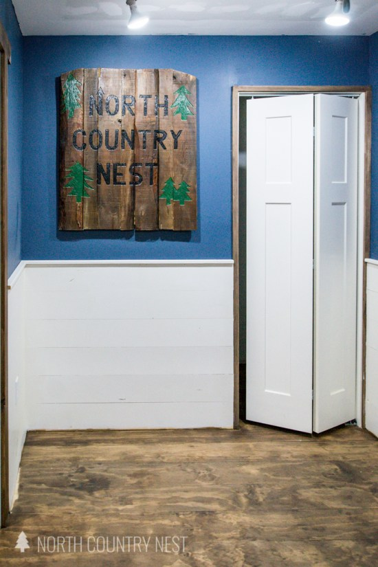 white shiplap and stained plywood floors