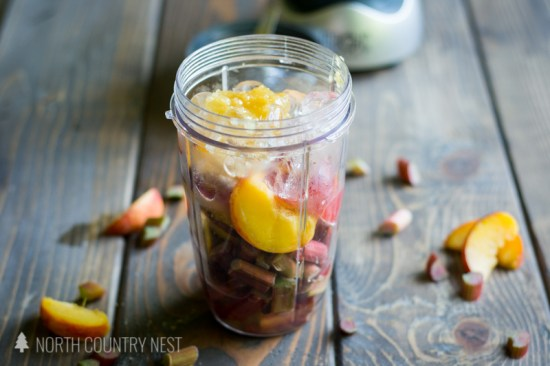 Nutribullet blender with ingredients for peach rhubarb smoothie