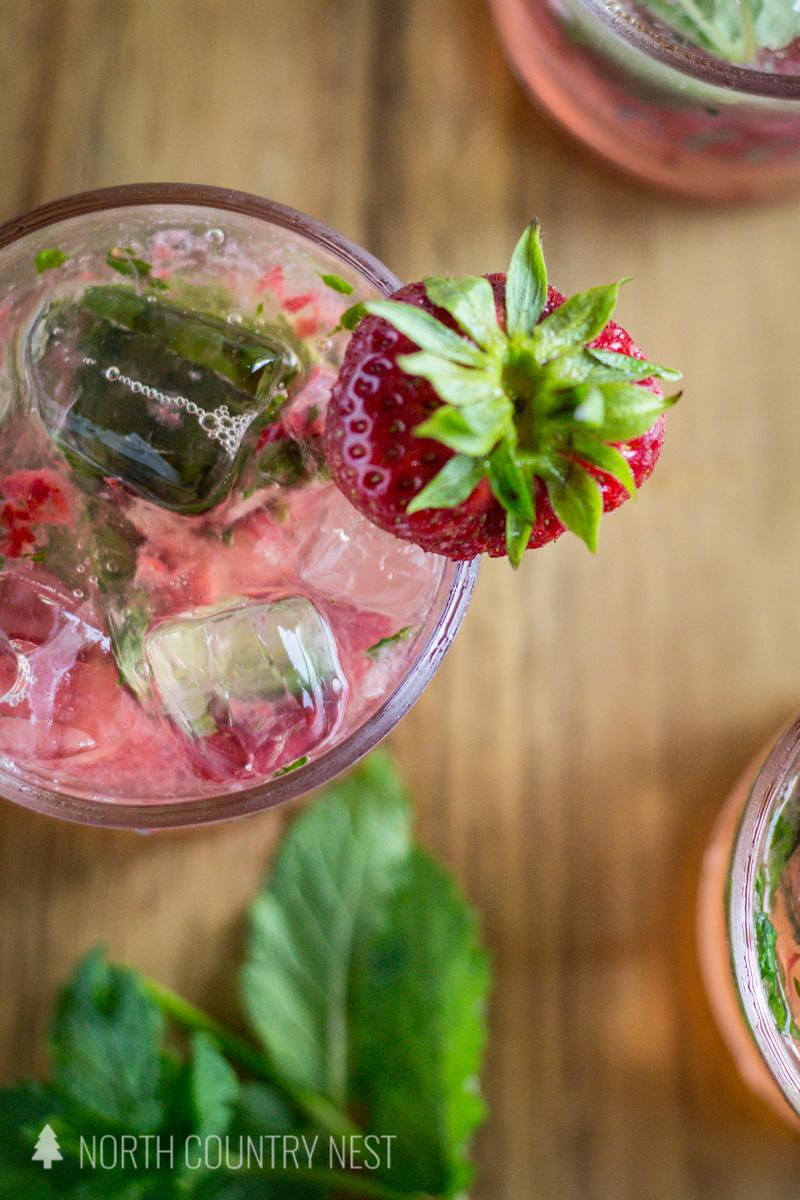 strawberry garnish on strawberry mint fizz cocktail