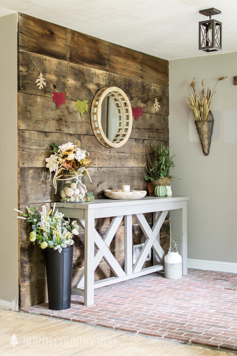 fall entryway with barn wood wall