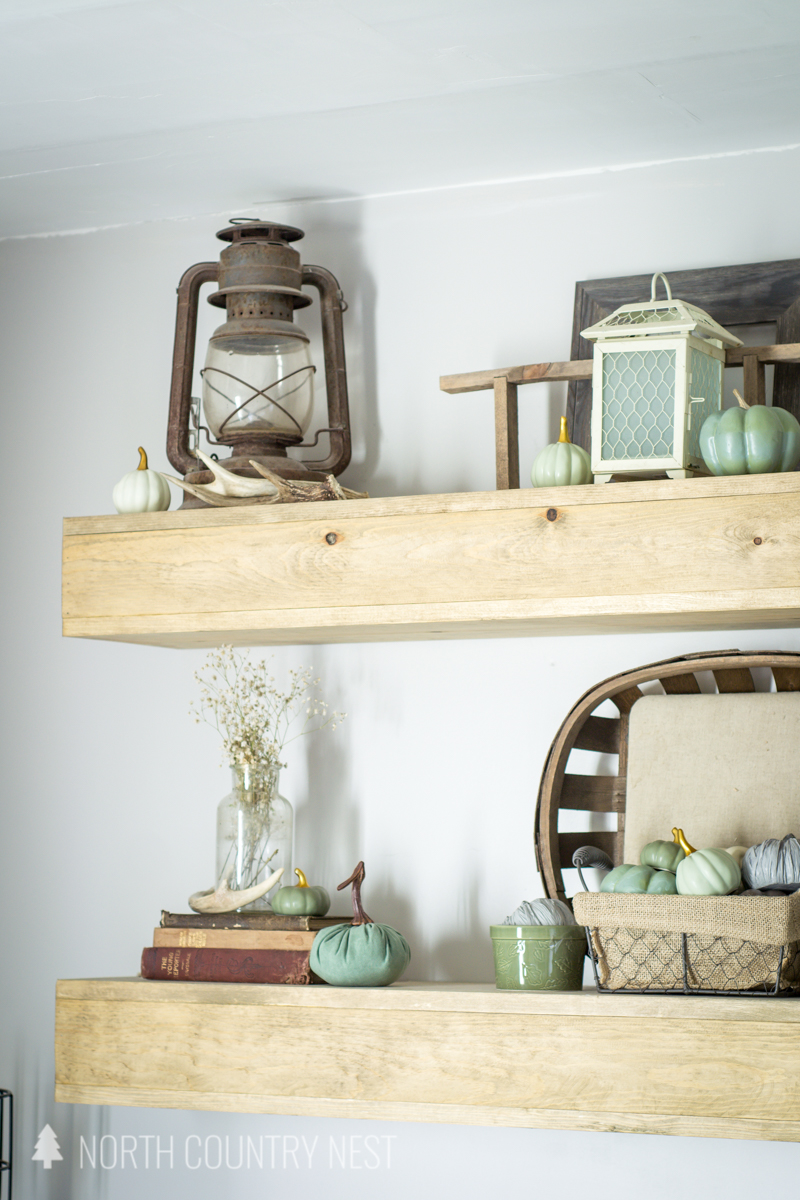 floating shelves with fall decor