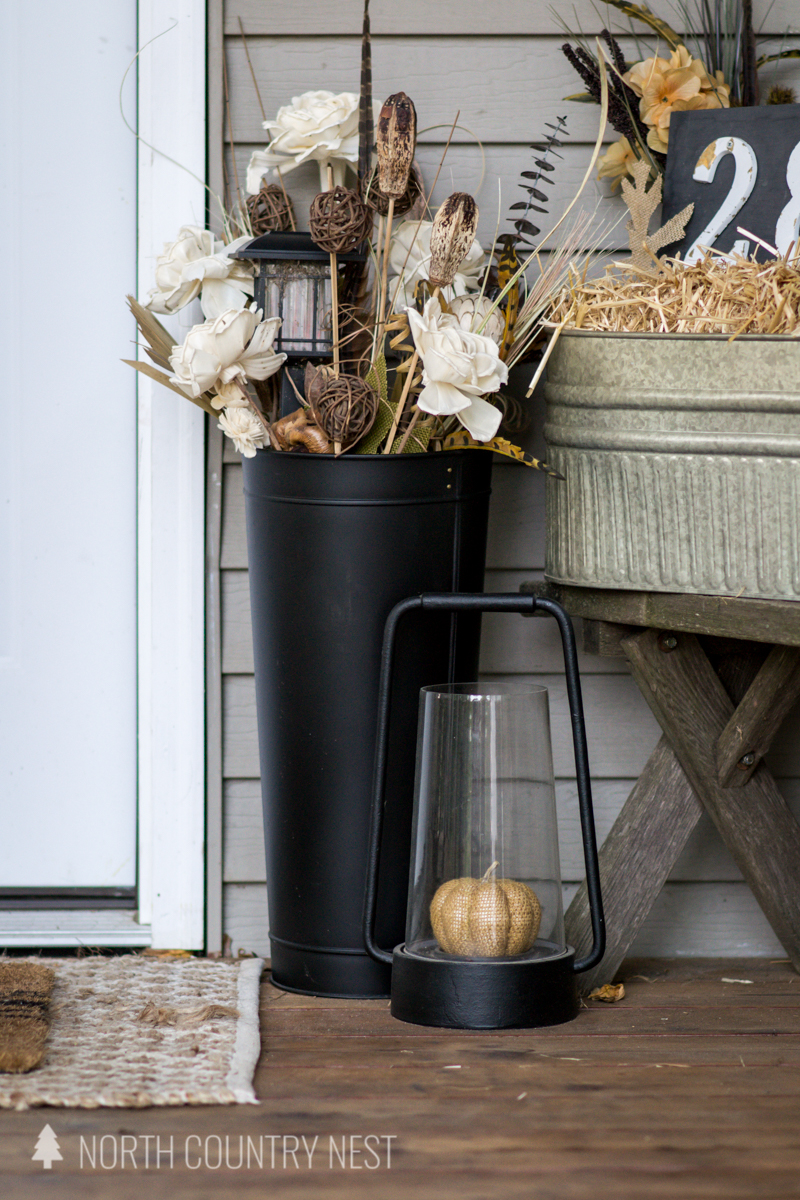 black tall vase on front porch