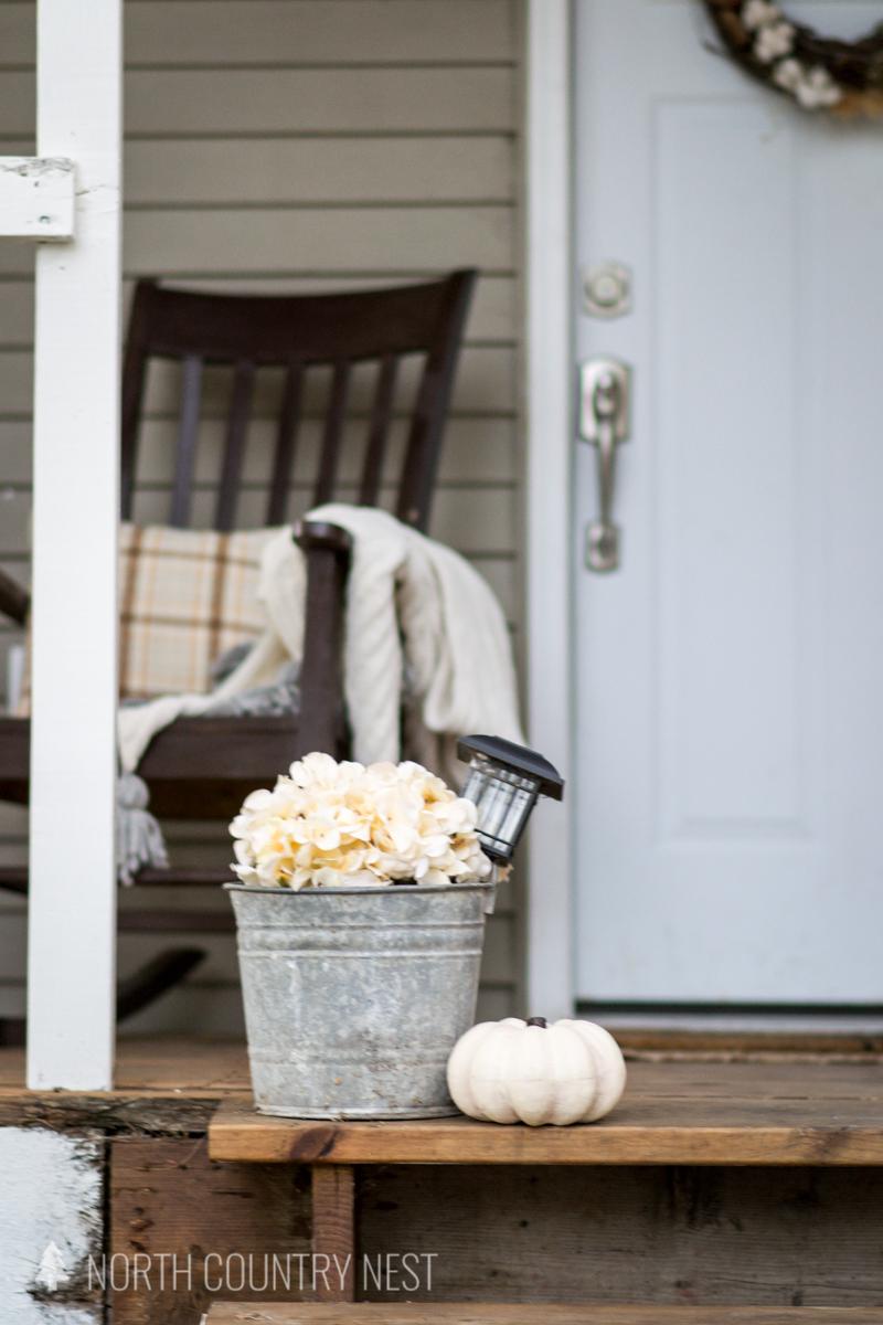 galvanized bucket and brown rocking chair