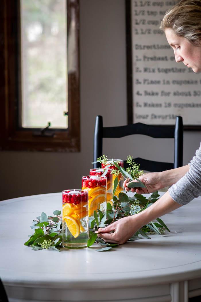 fresh fruit and eucalyptus kitchen table centerpiece