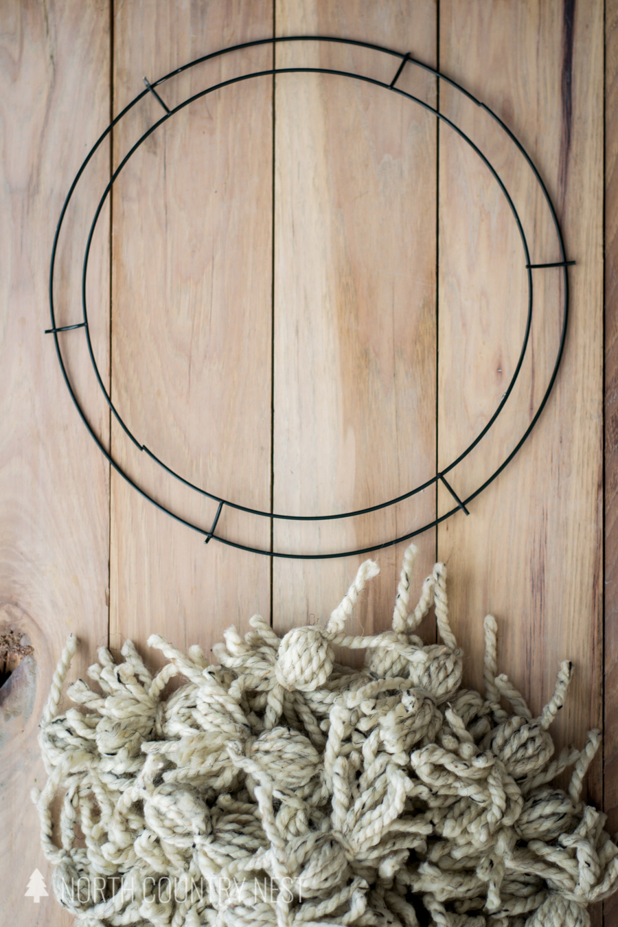 wire wreath frame and homemade poms