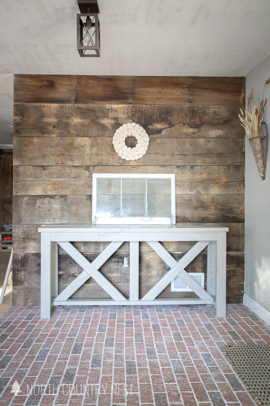 Entryway table with wreath and distressed window