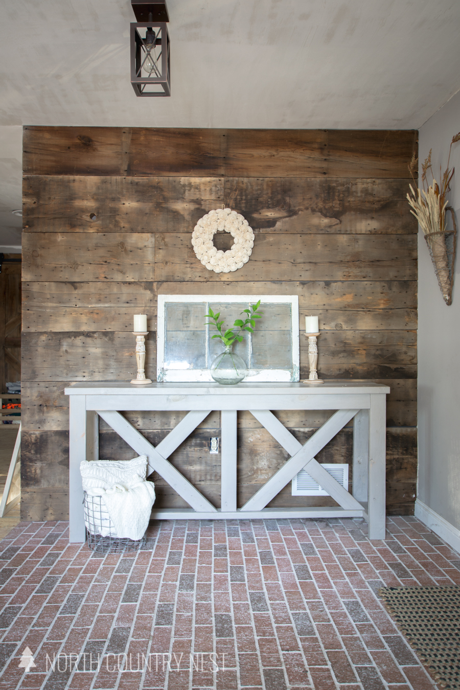 Rustic entryway table decor with pillow basket