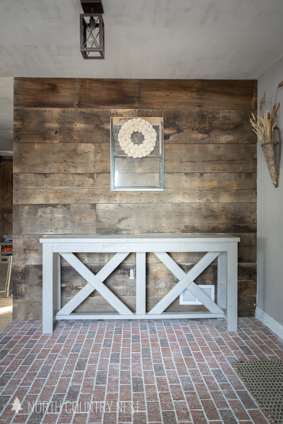 distressed window in entryway with rustic wreath