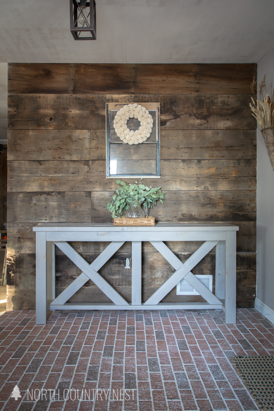 Entryway table with dried eucalyptus