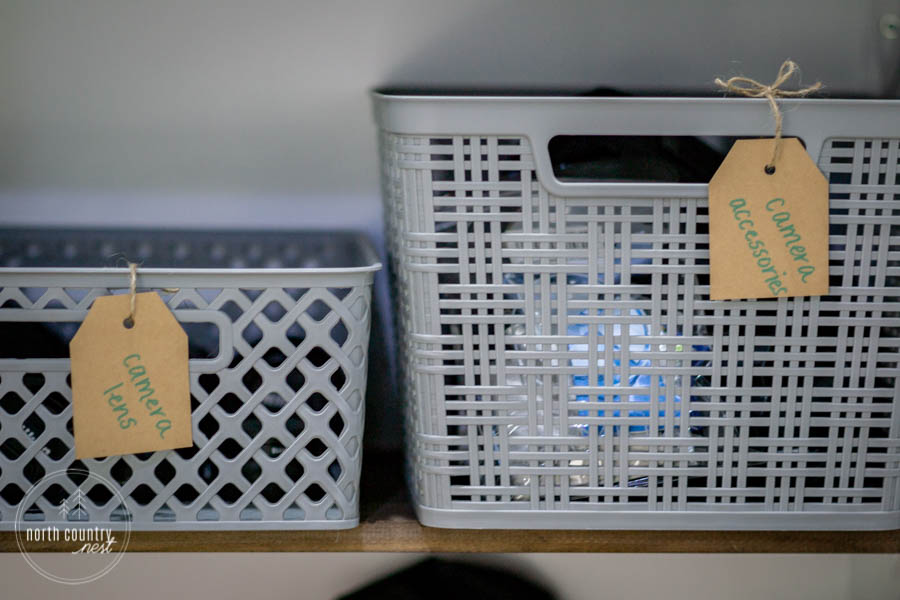gray plastic baskets with kraft paper labels
