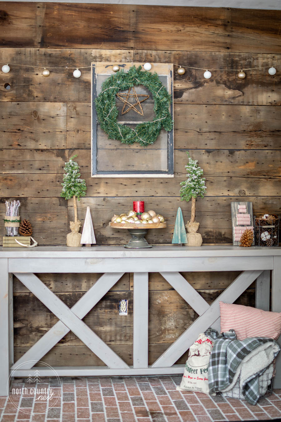 rustic entryway table with holiday decor