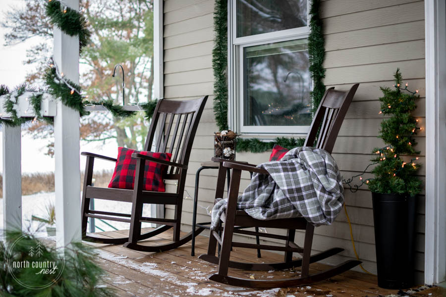 rocking chairs on front porch with plaid throw blanket
