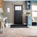 rustic modern front entryway with black front door