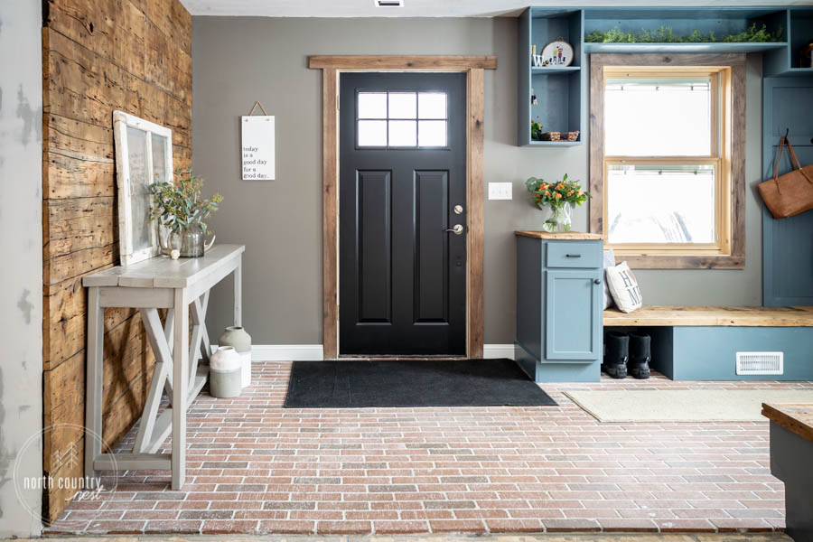 rustic modern front entryway with black front door