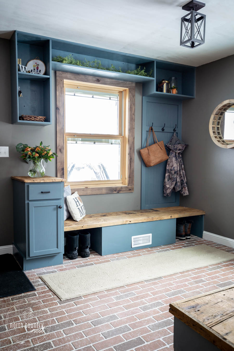 modern rustic entryway built-ins painted blue