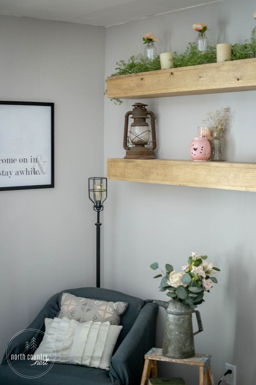spring bedroom reading nook and floating shelves