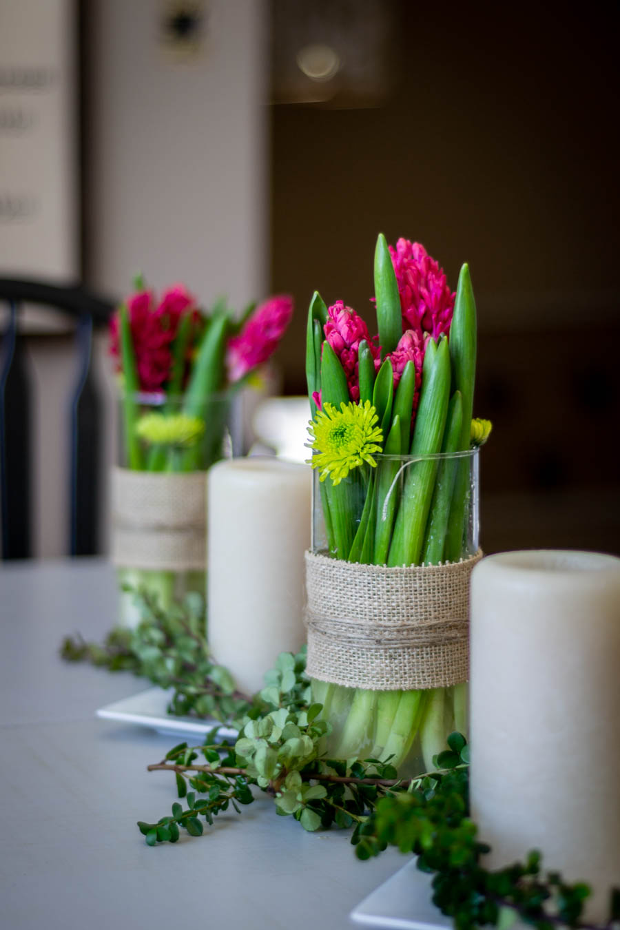 cylinder vases wrapped in burlap and twine for a simple spring floral centerpiece