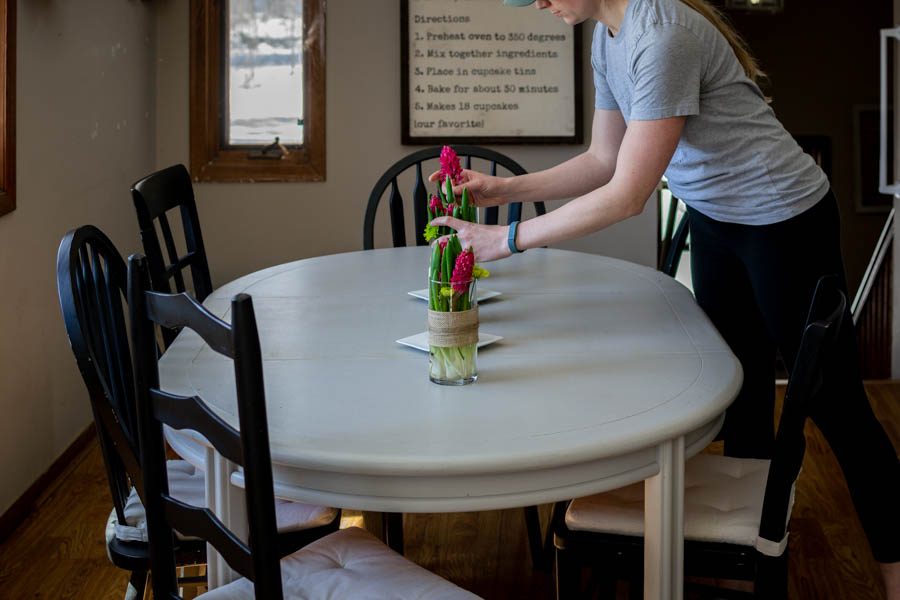 arranging flowers for a simple spring floral centerpiece