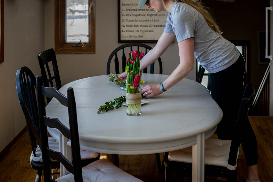 arranging green stems for a simple spring floral centerpiece