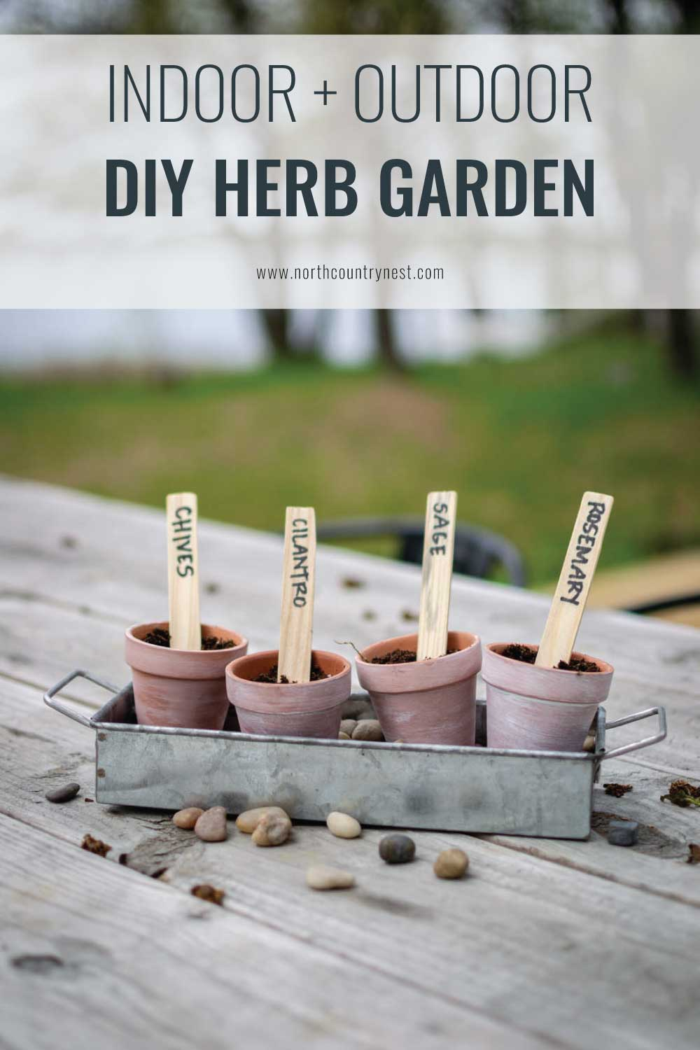 All you need are terracotta planters and a galvanized tray to make this industrial DIY herb garden that's suitable for indoors or out! | DIY container herb garden | North Country Nest #northcountrynest #herbgaren #DIY #containerherbgarden #indoorherbgarden