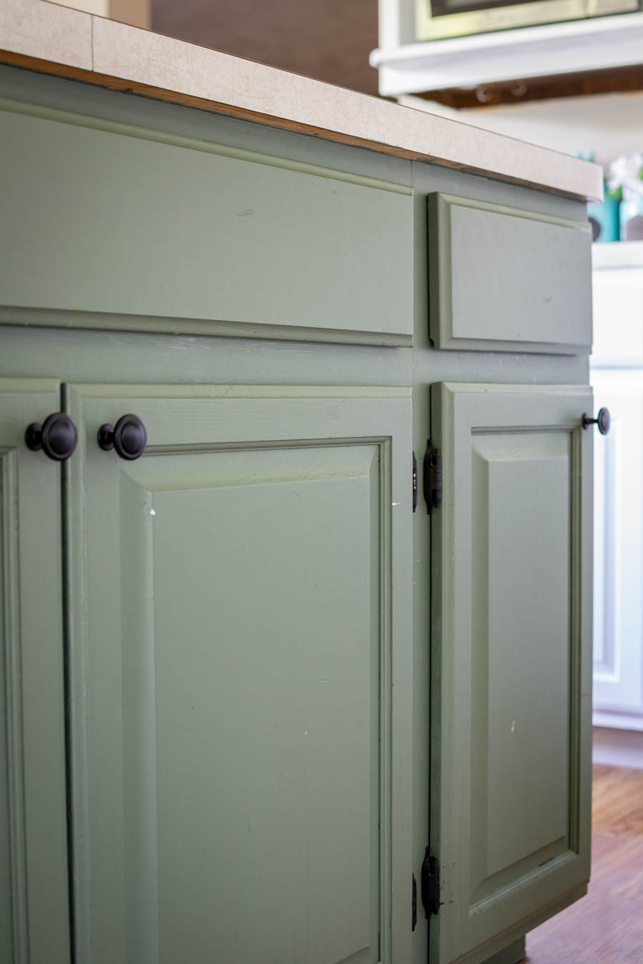 paint chipping on green kitchen island cabinets