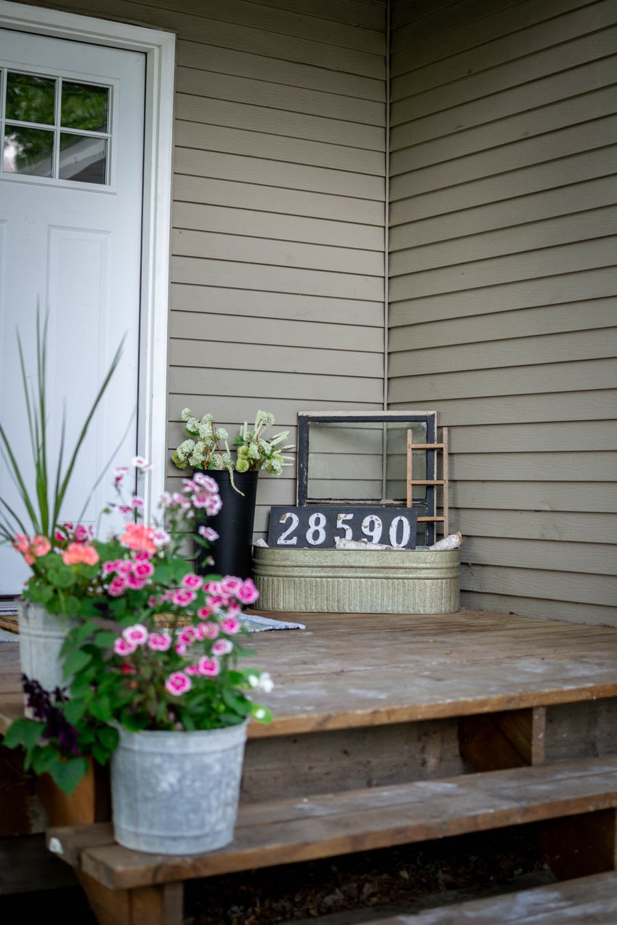galvanized planters on summer porch
