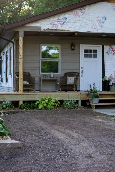 Rustic cedar front porch and retaining wall