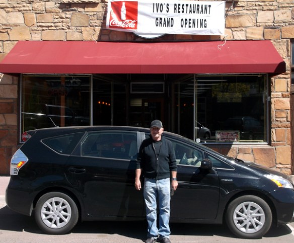 Ivo stands in front of his restaurant
