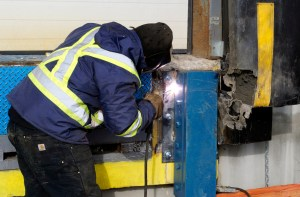technician welding dock bumper