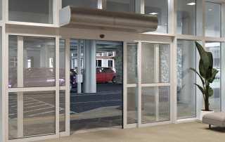 Architectural low profile air curtain sliding doors parking garage