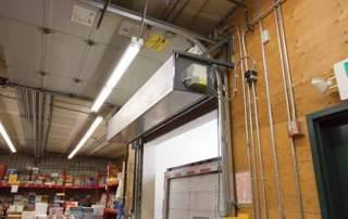 Industrial direct drive air curtain loading dock door
