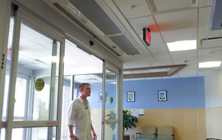 Architectural recessed air curtain doctors office sliding door entrance