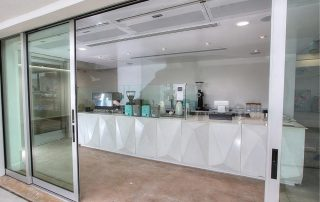 Architectural recessed air curtain coffee shop entrance