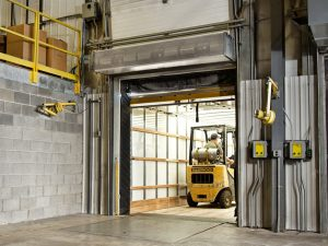 Industrial direct drive air curtain manufacturing plant loading dock