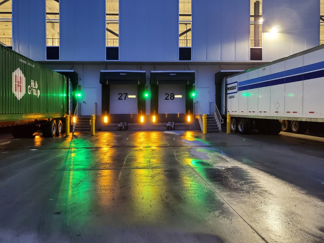 Superguide light shipping receiving dock area night time
