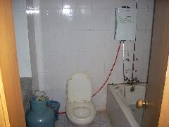 Internal gas hot water heater