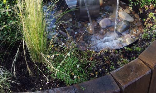 water trickling down on stones in a small garden