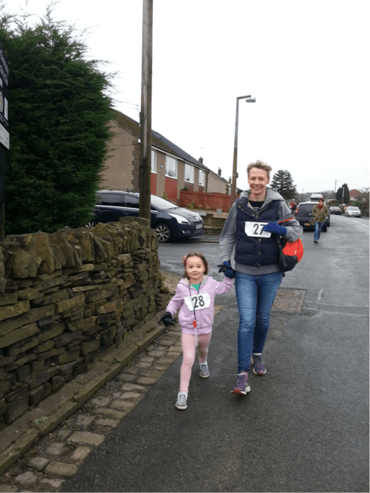 Rose, 4, leaps to the finish line with mum Kate