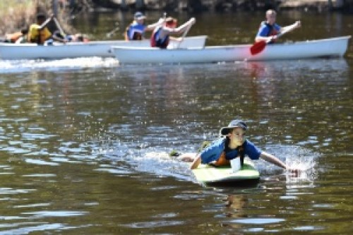Student on paddle board at Adventure Race