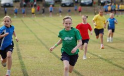 Students running in Primary Curricular sport program