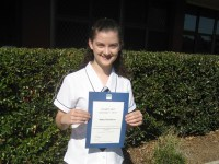Abby with her certificate of high distinction