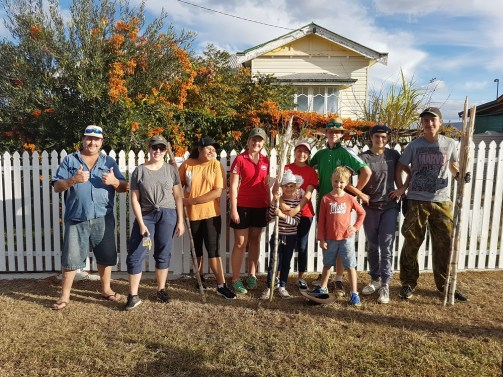 STORM Co students doing yard work