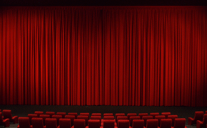 Pacific Theatres 10Plex Northridge  Movie Times   Tickets     Red curtains and chairs in a movie theater