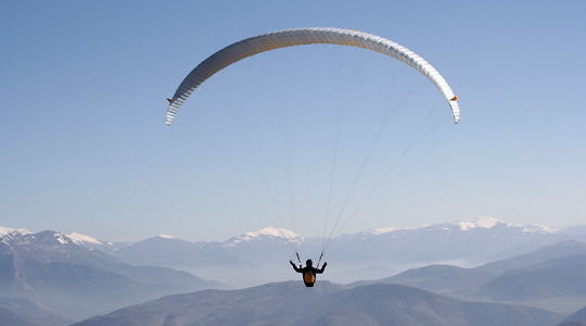 Image of a solo parachutist signifying controlled freedom