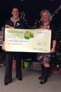 Caroline Pinnell of Waitrose presenting Angela Hicks with a cheque