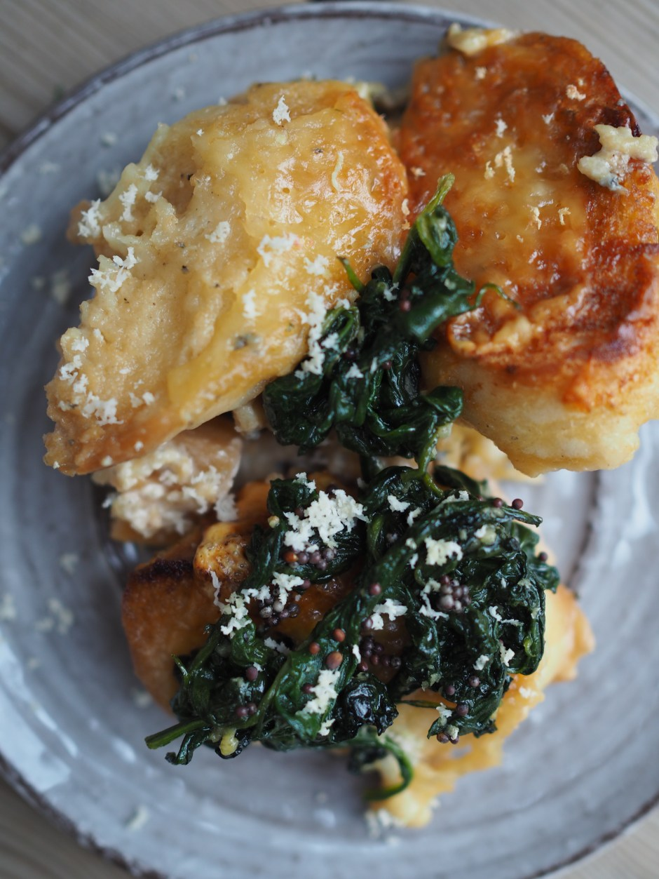 Cheesy Rutabaga & Beer Bake served with Vinegary Greens, Toasted Mustard Seeds and Horseradish