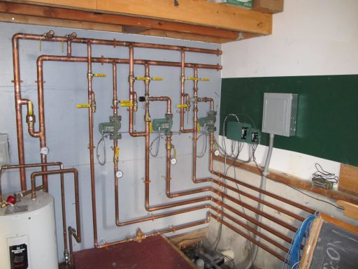 Copper pipes feeding hot water into the main building to heat our radiant floor.