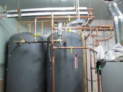 Two 400 gallon water tanks help store heat and improve efficiency.